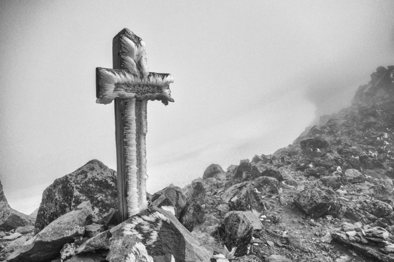 Grave marker on top of Old Snowy Mountain